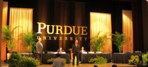 Mitch Daniels takes questions from media from the stage of Purdue's Loeb Playhouse following the announcement he would become the school's next president.