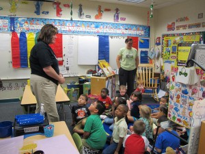 Janet Craig, left, and Maple Elementary outdoor learning center coordinator Jennifer Davies talk to the pre-kindergarten students about the importance of being quiet in the hallway at school.