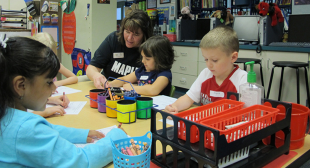 Teacher Janet Craig helps students identify colors during at pre-kindergarten camp at Maple Elementary in Avon, Ind. United Way funds the camp, which is staffed by local teachers and volunteers from the Indiana University Health system.