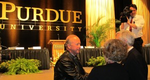 Gov. Mitch Daniels accepts congratulations after the Board of Trustees announced he would be the next president of Purdue University.