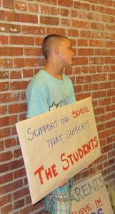 Parents and students arrived at Wednesday's emergency school board meetings holding homemade signs. Throughout the meeting, they cheered and chanted, 'Save our school!'