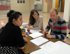 A group of new math teachers working at the three Indianapolis turnaround schools run by Charter Schools USA work on lesson plans. The Florida company relied heavily on Teach For America recruits to staff the schools last year.
