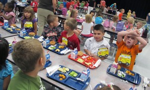 First graders at Wea Ridge Elementary in Lafayette eat lunch on Thursday, Aug. 16, 2012. Schools in Indiana and across the country are changing what they're serving to meet new federal school lunch guidelines.
