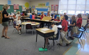 Students at St. Charles Catholic School in Bloomington prepare for a lesson on Thursday, Aug. 23, 2012.