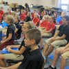 Students sing and play music games during choir class at St. Charles Catholic School in Bloomington.