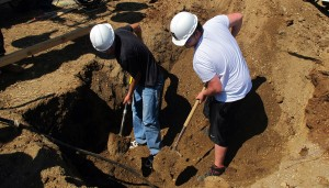 "Students in the C4 Columbus Area Career Connection building trades program dig a foundation for a out building on Aug. 30, 2012. Students work on one large-scale construction project each year — usually a house —€"" but this year they're building a new baseball complex for the Bartholomew School Corporation."