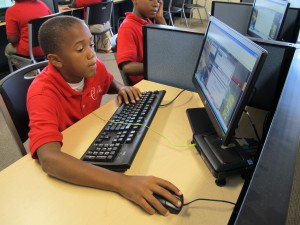 In this 2012 file photo, a Carpe Diem student logs onto a computer. Indiana's new science standards require a focus on computer science skills in elementary and middle school. (Kyle Stokes/ StateImpact Indiana)