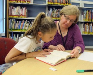 At the end of her tutoring session on Sept. 13, 2012, Alex Stein reads from 'The Boxcar Children.' Her mother, Jackie Stein, says her daughter is a more enthusiastic reader after a dyslexia diagnosis prompted the family to hire a tutor.