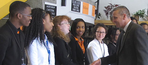 State superintendent Tony Bennett shakes hands with Broad Ripple High School students at an October 2012 press event highlighting the release of the A-F school ratings.