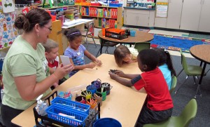 Students at a pre-kindergarten camp in Avon, Ind., play a counting game. The United Way program helps prepare students to start school.