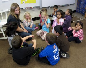 Students sing songs with their teacher at Busy Bees Academy, a public preschool in Columbus, Ind.