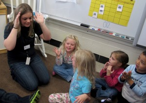 Students play an alligator game with their teacher at Busy Bees Academy, a public preschool in Columbus, Ind.