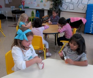 Students at Busy Bees Academy, a public preschool in Columbus, Ind., eat a jello snack they made as part of a class project.