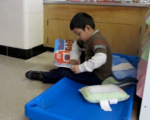 A student prepares for nap time at Busy Bees Academy, a public preschool in Columbus, Ind.