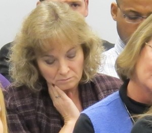 State superintendent-elect Glenda Ritz (left) attends the December State Board of Education meeting, taking notes and listening in during the debate over the proposed REPA II teacher licensing rules. She asked the rule changes be tabled. The board declined her request.