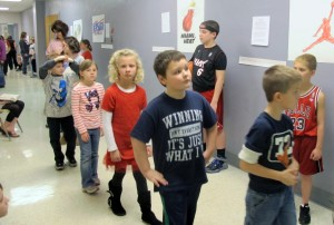 Younger students walk through the halls of Rockville Elementary School as fifth graders portray famous historical figures. The students can't talk or interact with their parents or peers while part of the Tableau Museum.