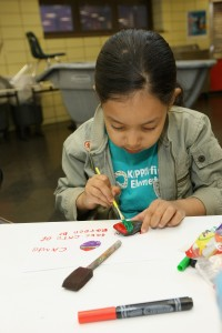 A charter school student participates in an art project.