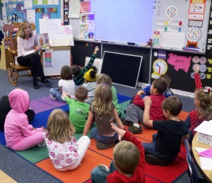 Students in Katherine Kenton's Tallahassee kindergarten class discuss a story about a gingerbread man. Kenton asks her class questions to check their comprehension, a key component of the new Common Core academic standards.