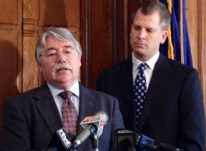 Attorney General Greg Zoeller (left) and State Sen. Pete Miller, R-Avon, speak at a Thursday news conference unveiling a proposed state grant program designed to put more police officers into Indiana schools.