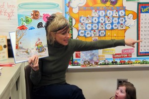 Lisa Coughanowr, a kindergarten teacher at East Side Elementary in Brazil, reads aloud to her students. She asks questions about the story to check their understanding.