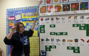 Kindergarten teacher Hannah Reinoehl reviews letter sounds with her students.