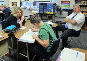 Principal Jeff Eslinger, right, watches as a sixth grade teacher helps a student with a math lesson. A turnaround specialist from the Indiana Department of Education visited Rockville to track implementation of the school improvement plan.