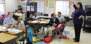 A math teacher leads a lesson on mathematic inequalities at Charter School of the Dunes in Gary. On average, kids in charter schools outperform their traditional public school counterparts in both math and reading.