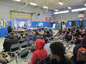 Parents pack into a large common room in the back of Charter School of the Dunes on a recent Thursday night.  They're here to watch student presentations — but the charter situation is clearly on everyone's minds.