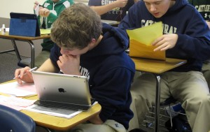 Students work on research papers in Melinda Bundy's ninth grade English class at Cathedral High School in Indianapolis.