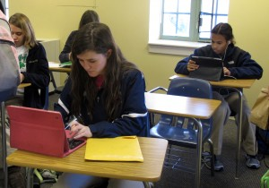 Students in Cathedral High School in Indianapolis research John F. Kennedy's presidency in Melinda Bundy's ninth grade English class.