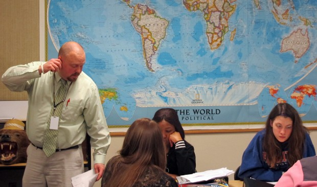Teacher Wes Upton answer a student's question in his social studies class at Ben Davis Ninth Grade Center in Indianapolis.