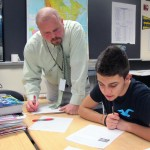 Teacher Wes Upton helps a student with an assignment in his social studies class at Ben Davis Ninth Grade Center in Indianapolis.