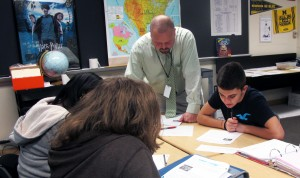 Teacher Wes Upton helps students with an assignment in his social studies class at Ben Davis Ninth Grade Center in Indianapolis.