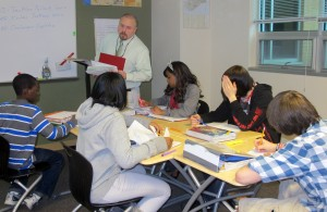 Teacher Wes Upton explains an assignment to students in his social studies class at Ben Davis Ninth Grade Center in Indianapolis.