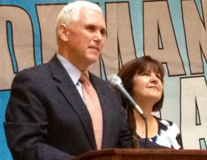 Gov. Mike Pence, standing with his wife Karen, speaks at the 'Ed Reform Rocks' rally at the Indiana Statehouse.