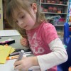 A Head Start student draws a picture of a princess.