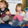 Head Start students at Eastview Elementary in Connersville listen as their teacher reads a book about dinosaurs.