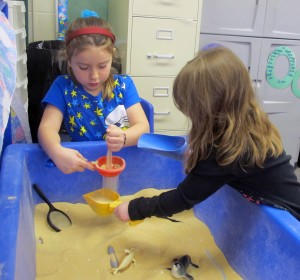 Head Start students develop fine motor skills playing at the sand table in their classroom at Eastview Elementary in Connersville.
