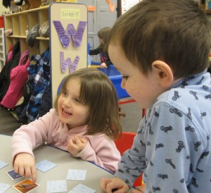 Head Start students at Eastview Elementary in Connersville play a card game that teaches memory and matching skills.