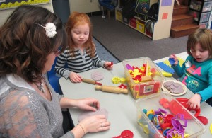 Working with play dough helps Head Start students develop fine motor skills while learning how to identify shapes and colors.