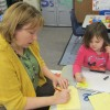 A Head Start teacher at Eastview Elementary in Connersville helps a student review letters.
