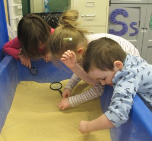 Playing at the sand table helps Head Start students at Eastview Elementary in Connersville develop fine motor skills.