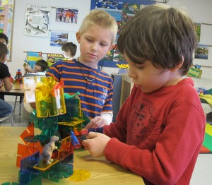 Students play with blocks at the Monroe County United Ministries childcare center.
