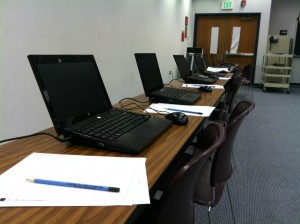 Laptops are set up with pencils and scratch paper at the ready in a temporary testing lab at Tecumseh Junior High in Lafayette.