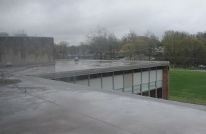 Rain puddles on the roof at Tuttle Middle School in Crawfordsville. The district will break ground on a new school in fall of 2013 and demolish the old building once it's ready to house students.