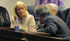 CTB/McGraw-Hill president Ellen Haley confers before a meeting of the Indiana Commission on Education on Friday.