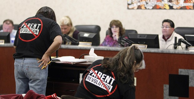 A parent speaks to the school board in Adelanto, Calif., regarding the state's parent trigger law.