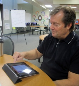 East Allen County Schools technology director Bill Diehl demonstrates an iTunes U course on his iPad.