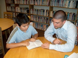 A tutor assists a student.