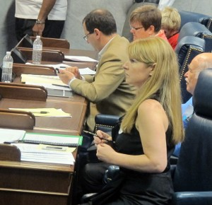 Erin Tuttle takes notes during a statehouse hearing on Common Core. Tuttle has helped lead the charge against the nationally-crafted academic standards.